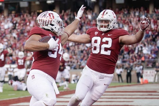 Oct 27, 2018; Stanford, CA, USA; Stanford Cardinal fullback Houston Heimuli (34) and tight end Kaden Smith (82) celebrate after scoring a touchdown against the Washington State Cougars during the second quarter at Stanford Stadium. Mandatory Credit: Stan Szeto-USA TODAY Sports