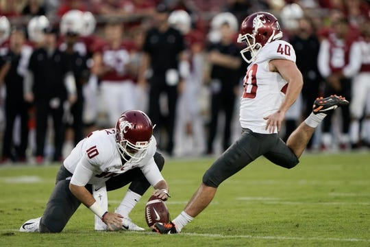 Oct 27, 2018; Stanford, CA, USA; Washington State Cougars quarterback Trey Tinsley (10) holds the ball for punter Blake Mazza (40) against the Stanford Cardinal during the third quarter at Stanford Stadium. Mandatory Credit: Stan Szeto-USA TODAY Sports