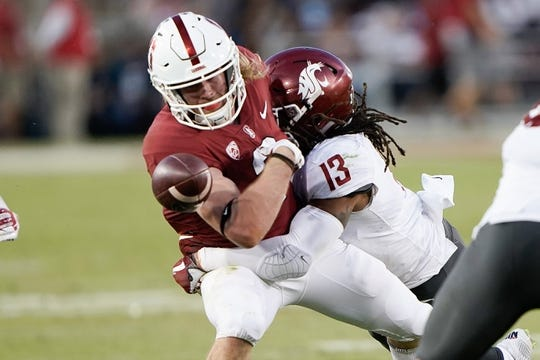 Oct 27, 2018; Stanford, CA, USA; Washington State Cougars linebacker Jahad Woods (13) knocks the ball loose from Stanford Cardinal wide receiver Trenton Irwin (2) during the third quarter at Stanford Stadium. Mandatory Credit: Stan Szeto-USA TODAY Sports