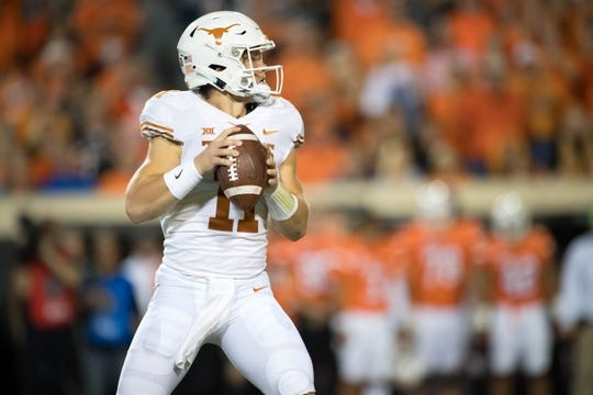 Oct 27, 2018; Stillwater, OK, USA; Texas Longhorns quarterback Sam Ehlinger (11) looks to pass against the Oklahoma State Cowboys during the first half at Boone Pickens Stadium. Mandatory Credit: Rob Ferguson-USA TODAY Sports
