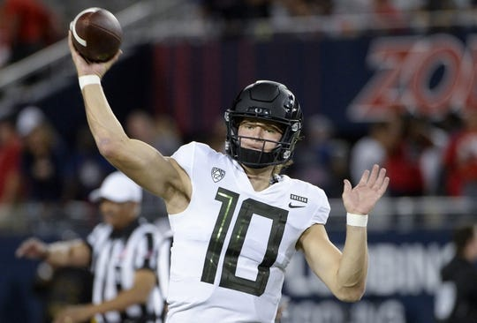 Oct 27, 2018; Tucson, AZ, USA; Oregon Ducks quarterback Justin Herbert (10) warms up before playing the Arizona Wildcats at Arizona Stadium. Mandatory Credit: Casey Sapio-USA TODAY Sports
