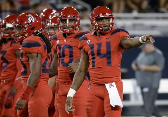 Oct 27, 2018; Tucson, AZ, USA; Arizona Wildcats quarterback Khalil Tate (14) warms up before playing the Oregon Ducks at Arizona Stadium. Mandatory Credit: Casey Sapio-USA TODAY Sports