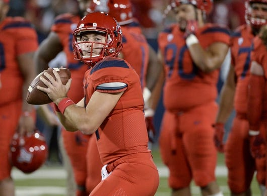 Oct 27, 2018; Tucson, AZ, USA; Arizona Wildcats quarterback Rhett Rodriguez (4) warms up before playing the Oregon Ducks at Arizona Stadium. Mandatory Credit: Casey Sapio-USA TODAY Sports