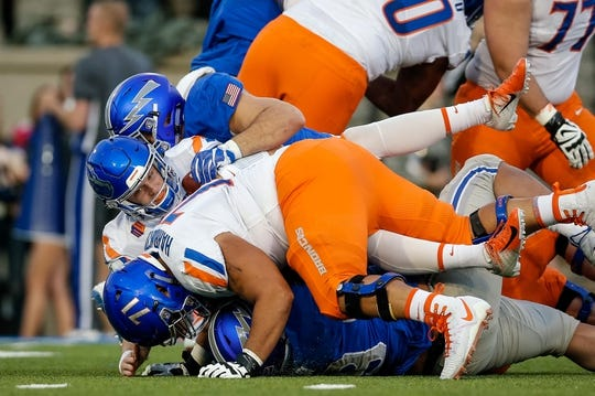 Oct 27, 2018; Colorado Springs, CO, USA; Boise State Broncos offensive lineman Donte Harrington (71) defends as quarterback Brett Rypien (4) is sacked by Air Force Falcons defensive lineman Micah Capra (90) and defensive lineman Mosese Fifita (99) in the second quarter at Falcon Stadium. Mandatory Credit: Isaiah J. Downing-USA TODAY Sports