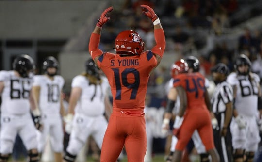 Oct 27, 2018; Tucson, AZ, USA; Arizona Wildcats safety Scottie Young Jr. (19) motions to the crowd during the first half against the Oregon Ducks at Arizona Stadium. Mandatory Credit: Casey Sapio-USA TODAY Sports