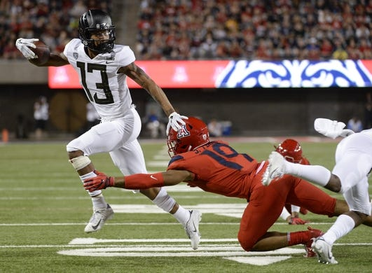 Oct 27, 2018; Tucson, AZ, USA; Oregon Ducks wide receiver Dillon Mitchell (13) runs the ball as Arizona Wildcats safety Scottie Young Jr. (19) defends during the first half at Arizona Stadium. Mandatory Credit: Casey Sapio-USA TODAY Sports
