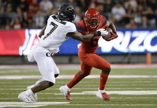 Oct 27, 2018; Tucson, AZ, USA; Arizona Wildcats wide receiver Shun Brown (6) runs the ball as Oregon Ducks safety Ugochukwu Amadi (7) defends during the first half at Arizona Stadium. Mandatory Credit: Casey Sapio-USA TODAY Sports