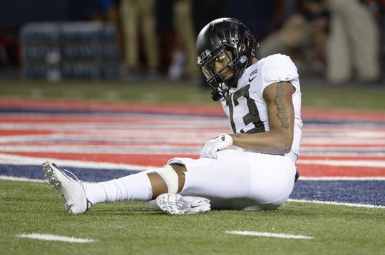 Oct 27, 2018; Tucson, AZ, USA; Oregon Ducks wide receiver Dillon Mitchell (13) is slow to get up during the first half against the Arizona Wildcats at Arizona Stadium. Mandatory Credit: Casey Sapio-USA TODAY Sports