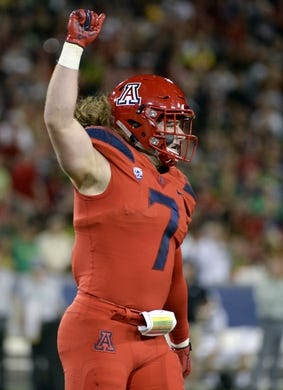 Oct 27, 2018; Tucson, AZ, USA; Arizona Wildcats linebacker Colin Schooler (7) celebrates after making a stop against the Oregon Ducks at Arizona Stadium. Mandatory Credit: Casey Sapio-USA TODAY Sports