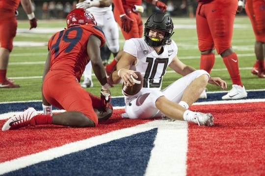 Oct 27, 2018; Tucson, AZ, USA; Oregon Ducks quarterback Justin Herbert (10) scores the two point conversion during the first half against the Arizona Wildcats at Arizona Stadium. Mandatory Credit: Casey Sapio-USA TODAY Sports