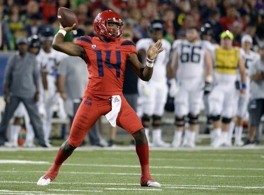 Oct 27, 2018; Tucson, AZ, USA; Arizona Wildcats quarterback Khalil Tate (14) passes the ball against the Oregon Ducks during the second half at Arizona Stadium. Mandatory Credit: Casey Sapio-USA TODAY Sports