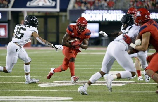 Oct 27, 2018; Tucson, AZ, USA; Arizona Wildcats wide receiver Shun Brown (6) runs the ball under pressure from Oregon Ducks safety Nick Pickett (16) during the second half at Arizona Stadium. Mandatory Credit: Casey Sapio-USA TODAY Sports