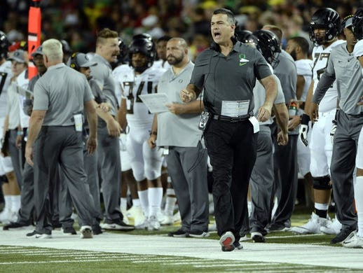 Oct 27, 2018; Tucson, AZ, USA; Oregon Ducks head coach Mario Cristobal calls to his players during the first half against the Arizona Wildcats at Arizona Stadium. Mandatory Credit: Casey Sapio-USA TODAY Sports