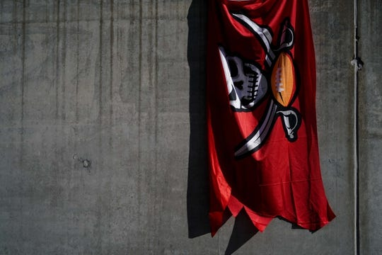 Oct 28, 2018; Cincinnati, OH, USA; A fan holds a Buccaneers flag prior to the game of the Tampa Bay Buccaneers against the Cincinnati Bengals at Paul Brown Stadium. Mandatory Credit: Aaron Doster-USA TODAY Sports