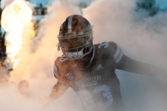 Oct 27, 2018; Starkville, MS, USA; Mississippi State Bulldogs running back Robert Rivers (33) runs through the smoke as the Bulldogs take the field against the Texas A&M Aggies before the first half at Davis Wade Stadium. Mandatory Credit: Vasha Hunt-USA TODAY Sports