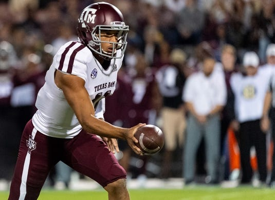 Oct 27, 2018; Starkville, MS, USA; Texas A&M Aggies quarterback Kellen Mond (11) hands off during the first half against the Mississippi State Bulldogs at Davis Wade Stadium. Mandatory Credit: Vasha Hunt-USA TODAY Sports