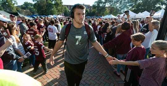 Oct 27, 2018; Starkville, MS, USA; Mississippi State Bulldogs quarterback Nick Fitzgerald (7) greets fans as the Mississippi State Bulldogs participate in Dawgwalk before the game with the Texas A&M Aggies at Davis Wade Stadium. Mandatory Credit: Vasha Hunt-USA TODAY Sports