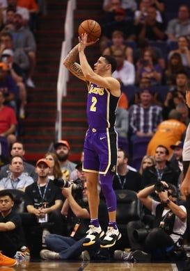 Oct 24, 2018; Phoenix, AZ, USA; Los Angeles Lakers guard Lonzo Ball (2) against the Phoenix Suns at Talking Stick Resort Arena. Mandatory Credit: Mark J. Rebilas-USA TODAY Sports