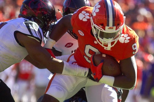 Nov 3, 2018; Clemson, SC, USA; Clemson Tigers running back Travis Etienne (9) breaks through tacklers to score a touchdown during the first quarter against the Louisville Cardinals at Clemson Memorial Stadium. Mandatory Credit: Joshua S. Kelly-USA TODAY Sports