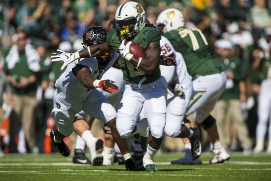 Nov 3, 2018; Waco, TX, USA; Baylor Bears running back JaMycal Hasty (6) runs for a first down against the Oklahoma State Cowboys during the first half at McLane Stadium. Mandatory Credit: Jerome Miron-USA TODAY Sports