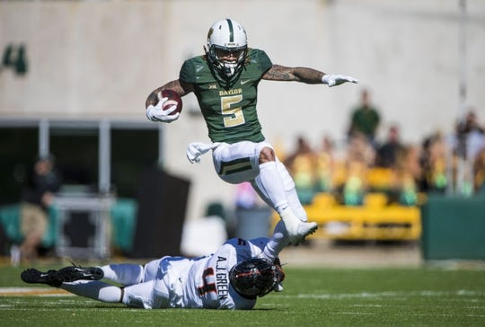 Nov 3, 2018; Waco, TX, USA; Baylor Bears wide receiver Jalen Hurd (5) leaps over Oklahoma State Cowboys cornerback A.J. Green (4) during the first half at McLane Stadium. Mandatory Credit: Jerome Miron-USA TODAY Sports
