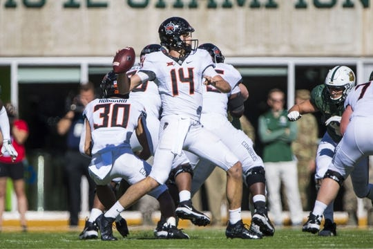 Nov 3, 2018; Waco, TX, USA; Oklahoma State Cowboys quarterback Taylor Cornelius (14) passes against the Baylor Bears during the first half at McLane Stadium. Mandatory Credit: Jerome Miron-USA TODAY Sports