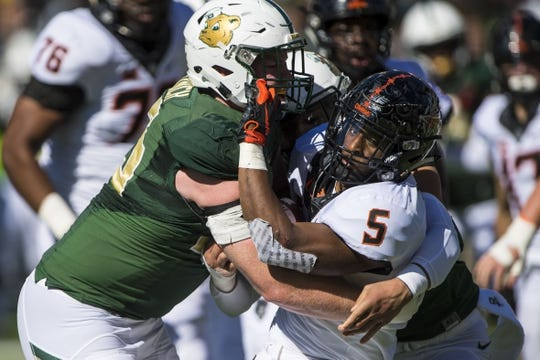 Nov 3, 2018; Waco, TX, USA; Oklahoma State Cowboys running back Justice Hill (5) is tackled by Baylor Bears defensive tackle James Lynch (93) during the first half at McLane Stadium. Mandatory Credit: Jerome Miron-USA TODAY Sports
