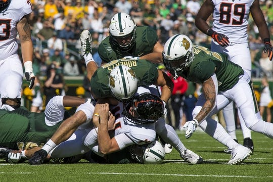 Nov 3, 2018; Waco, TX, USA; Oklahoma State Cowboys quarterback Taylor Cornelius (14) is sacked by Baylor Bears defensive end Greg Roberts (52) during the first half at McLane Stadium. Mandatory Credit: Jerome Miron-USA TODAY Sports