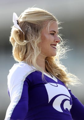 Nov 3, 2018; Fort Worth, TX, USA; Kansas State Wildcats cheerleader performs before the game against the TCU Horned Frogs at Amon G. Carter Stadium. Mandatory Credit: Kevin Jairaj-USA TODAY Sports