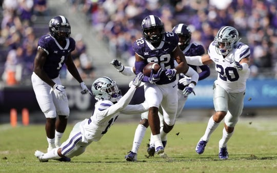 Nov 3, 2018; Fort Worth, TX, USA; TCU Horned Frogs wide receiver Jarrison Stewart (22) runs with the ball as Kansas State Wildcats defensive back AJ Parker (12) defends during the first quarter at Amon G. Carter Stadium. Mandatory Credit: Kevin Jairaj-USA TODAY Sports