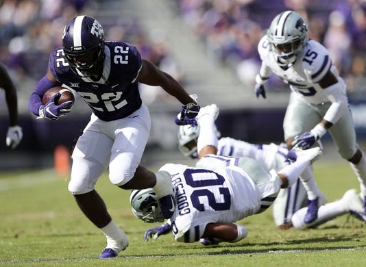Nov 3, 2018; Fort Worth, TX, USA; TCU Horned Frogs wide receiver Jarrison Stewart (22) runs with the ball as Kansas State Wildcats defensive back Denzel Goolsby (20) defends during the first quarter at Amon G. Carter Stadium. Mandatory Credit: Kevin Jairaj-USA TODAY Sports