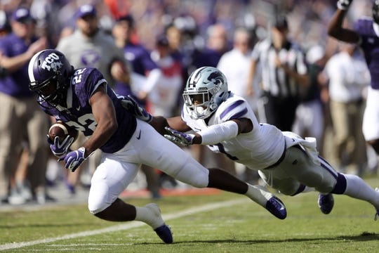 Nov 3, 2018; Fort Worth, TX, USA; TCU Horned Frogs wide receiver Jarrison Stewart (22) runs with the ball as Kansas State Wildcats defensive back Eli Walker (7) defends during the first quarter at Amon G. Carter Stadium. Mandatory Credit: Kevin Jairaj-USA TODAY Sports
