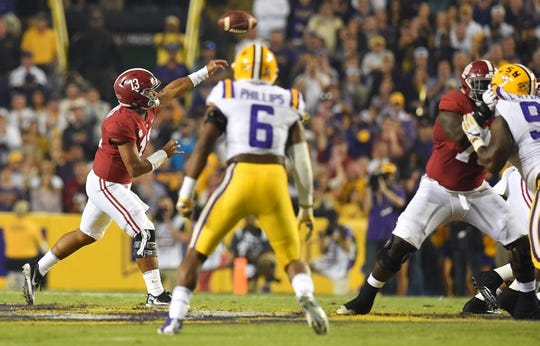 Nov 3, 2018; Baton Rouge, LA, USA; Alabama Crimson Tide quarterback Tua Tagovailoa (13) passing against the LSU Tigers during the first quarter at Tiger Stadium. Mandatory Credit: John David Mercer-USA TODAY Sports