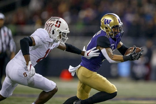 Nov 3, 2018; Seattle, WA, USA; Washington Huskies wide receiver Andre Baccellia (5) catches a pass in front of Stanford Cardinal cornerback Paulson Adebo (11) during the first quarter at Husky Stadium. Mandatory Credit: Jennifer Buchanan-USA TODAY Sports