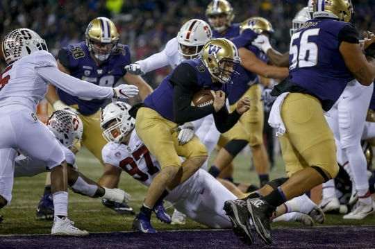 Nov 3, 2018; Seattle, WA, USA; Washington Huskies quarterback Jake Browning (3) gets into the end zone for a rushing touchdown against the Stanford Cardinal during the first quarter at Husky Stadium. Mandatory Credit: Jennifer Buchanan-USA TODAY Sports