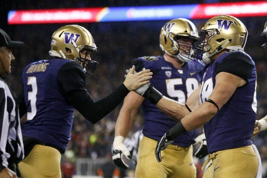 Nov 3, 2018; Seattle, WA, USA; Washington Huskies quarterback Jake Browning (3) high fives tight end Drew Sample (88) after Sample scored on a reception from Browning against the Stanford Cardinal during the first quarter at Husky Stadium. Mandatory Credit: Jennifer Buchanan-USA TODAY Sports