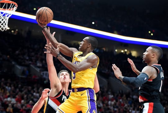 Nov 3, 2018; Portland, OR, USA; Los Angeles Lakers guard Rajon Rondo (9) drives to the basket on Portland Trail Blazers forward Zach Collins (33) during the first half of the game at the Moda Center. Mandatory Credit: Steve Dykes-USA TODAY Sports