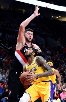 Nov 3, 2018; Portland, OR, USA; Portland Trail Blazers center Jusuf Nurkic (27) defends against Los Angeles Lakers forward Brandon Ingram (14) during the first half of the game at the Moda Center. Mandatory Credit: Steve Dykes-USA TODAY Sports