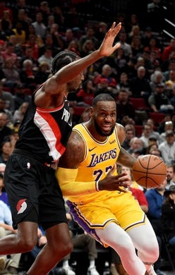 Nov 3, 2018; Portland, OR, USA; Los Angeles Lakers forward LeBron James (23) drives to the basket on Portland Trail Blazers forward Al-Farouq Aminu (8) during the first half of the game at the Moda Center. Mandatory Credit: Steve Dykes-USA TODAY Sports