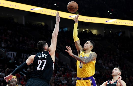 Nov 3, 2018; Portland, OR, USA; Los Angeles Lakers forward Kyle Kuzma (0) shoots the ball over Portland Trail Blazers center Jusuf Nurkic (27) during the first half of the game at the Moda Center. Mandatory Credit: Steve Dykes-USA TODAY Sports