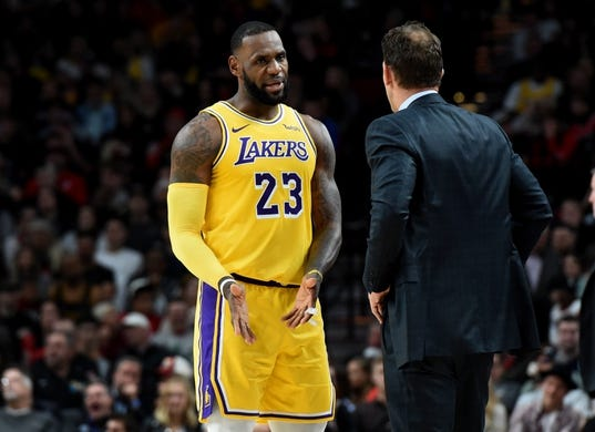 Nov 3, 2018; Portland, OR, USA; Los Angeles Lakers forward LeBron James (23) speaks with head coach Luke Walton during the first half of the game against the Portland Trail Blazers at the Moda Center. Mandatory Credit: Steve Dykes-USA TODAY Sports