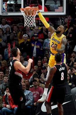 Nov 3, 2018; Portland, OR, USA; Los Angeles Lakers forward LeBron James (23) dunks the ball on Portland Trail Blazers center Jusuf Nurkic (27) during the second half of the game at the Moda Center. The Lakers won the game 114-110. Mandatory Credit: Steve Dykes-USA TODAY Sports