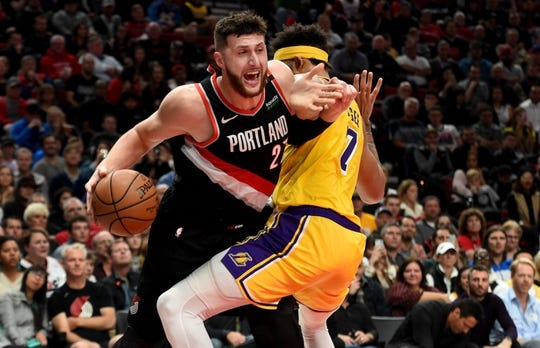 Nov 3, 2018; Portland, OR, USA; Portland Trail Blazers center Jusuf Nurkic (27) tries to get around Los Angeles Lakers center JaVale McGee (7)  during the second half of the game at the Moda Center. The Lakers won the game 114-110. Mandatory Credit: Steve Dykes-USA TODAY Sports