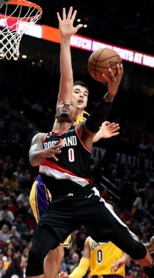 Nov 3, 2018; Portland, OR, USA; Portland Trail Blazers guard Damian Lillard (0) drives to the basket on Los Angeles Lakers center Ivica Zubac (40) during the second half of the game at the Moda Center. The Lakers won the game 114-110. Mandatory Credit: Steve Dykes-USA TODAY Sports