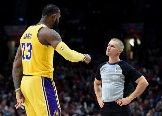 Nov 3, 2018; Portland, OR, USA; Los Angeles Lakers forward LeBron James (23) talks with referee Tyler Ford (39)  during the second half of the game at the Moda Center. The Lakers won the game 114-110. Mandatory Credit: Steve Dykes-USA TODAY Sports