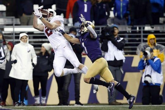 Nov 3, 2018; Seattle, WA, USA; Stanford Cardinal wide receiver Trenton Irwin (2) catches a 33-yard touchdown pass against Washington Huskies defensive back Byron Murphy (1) during the fourth quarter at Husky Stadium. Mandatory Credit: Jennifer Buchanan-USA TODAY Sports