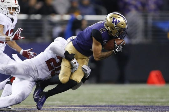 Nov 3, 2018; Seattle, WA, USA; Washington Huskies wide receiver Aaron Fuller (2) catches a pass against the Stanford Cardinal during the fourth quarter at Husky Stadium. Mandatory Credit: Jennifer Buchanan-USA TODAY Sports