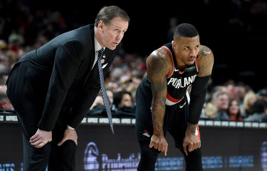 Nov 3, 2018; Portland, OR, USA; Portland Trail Blazers head coach Terry Stotts speaks with guard Damian Lillard (0) during the second half of the game against the Los Angeles Lakers at the Moda Center. The Lakers won the game 114-110. Mandatory Credit: Steve Dykes-USA TODAY Sports