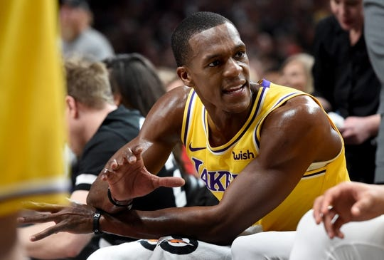 Nov 3, 2018; Portland, OR, USA; Los Angeles Lakers guard Rajon Rondo (9) speaks to his teammates during a timeout in the second half of the game against the Portland Trail Blazers at the Moda Center. The Lakers won the game 114-110. Mandatory Credit: Steve Dykes-USA TODAY Sports