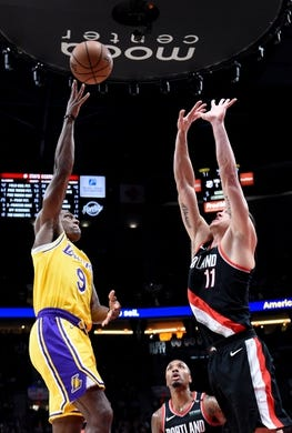 Nov 3, 2018; Portland, OR, USA; Los Angeles Lakers guard Rajon Rondo (9) puts up a shot over Portland Trail Blazers forward Meyers Leonard (11) during the second half of the game at the Moda Center. The Lakers won the game 114-110. Mandatory Credit: Steve Dykes-USA TODAY Sports